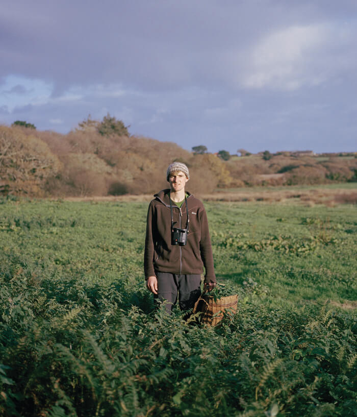 Jaime Molina - Gatherers man picking plants from field
