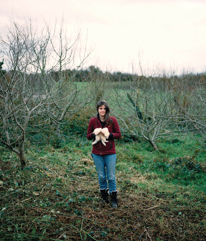 Jaime Molina - Gatherers women holding chickens