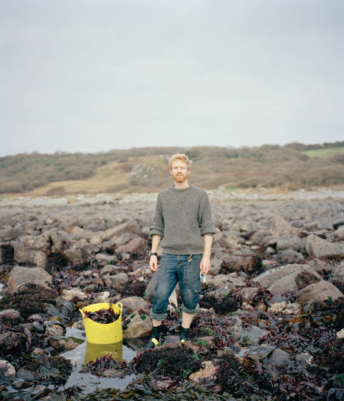 Jaime Molina - Gatherers man collecting sea weed on beach