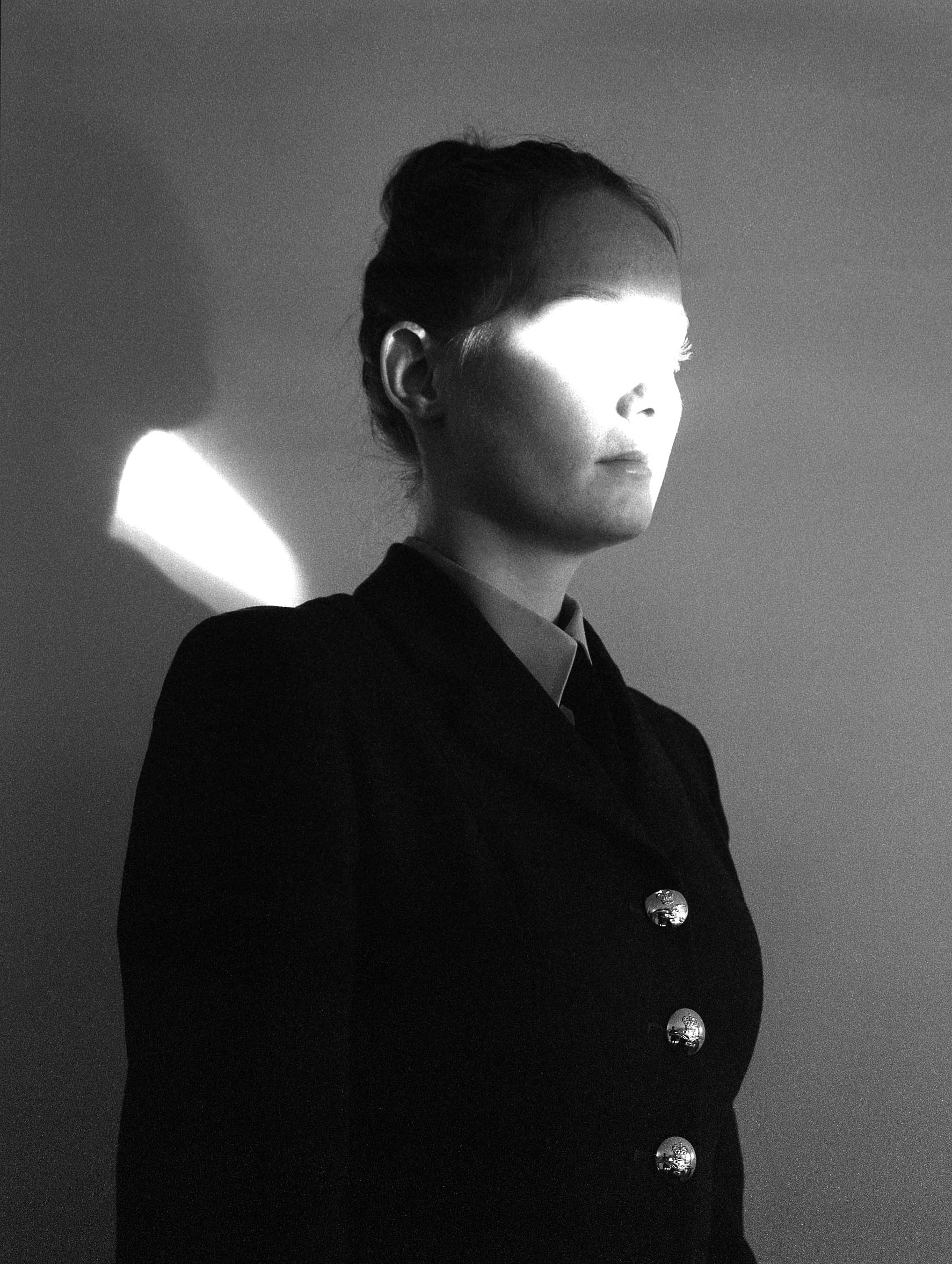 Rosie Dale - Runaways portrait of women with bright light shining on her face