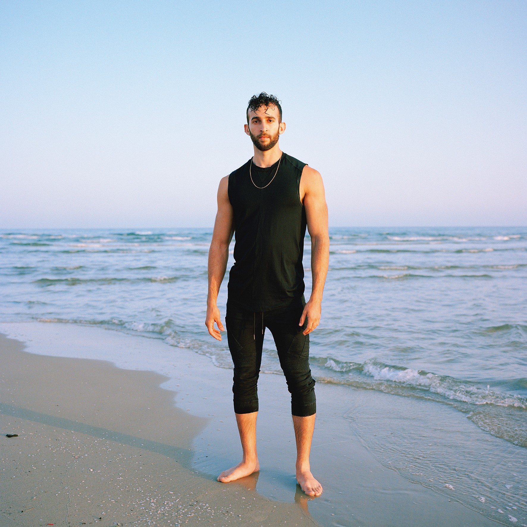 Pascal Haas: Tel—Avivis the south west collective of photography topless man stood on beach
