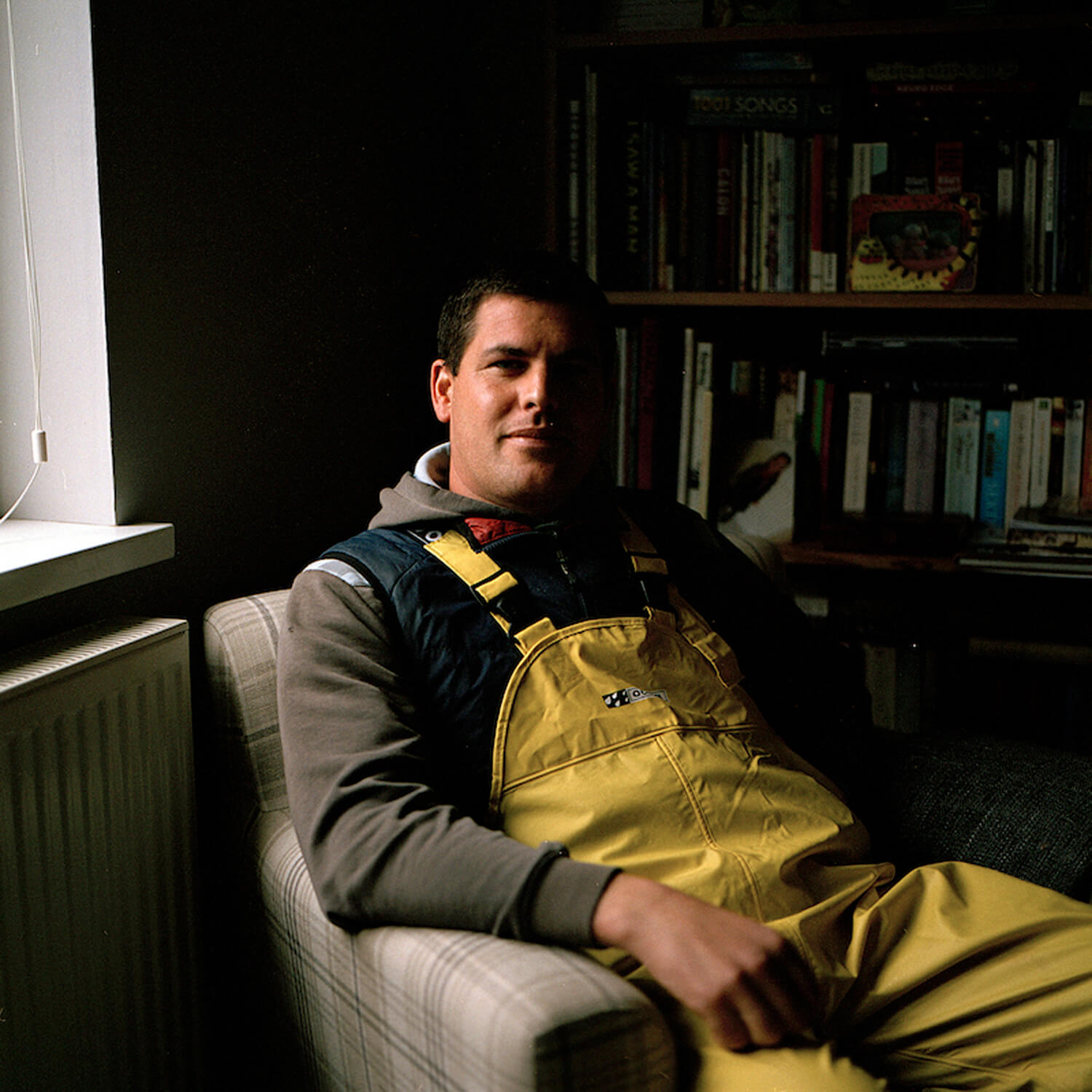 Eva Watkins - Old Salt the south west collective of photography portrait of fisherman in yellow gear