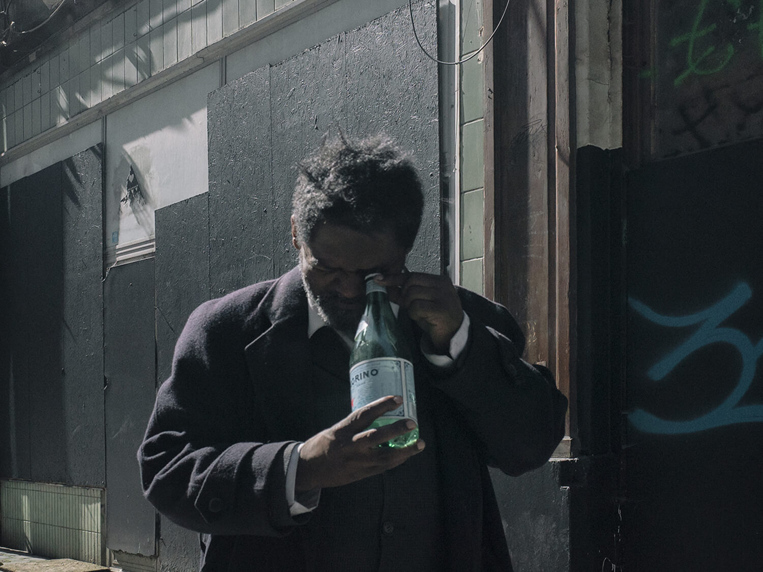 Anargyros Drolapas – Lernaean Hydra the south west collective of photography man looking into glass bottle