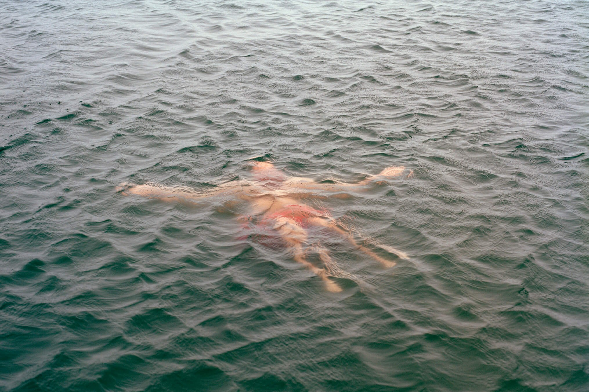 Elliot Cole - A Hull to Hold the Waves at Bay the south west collective of photography person floating in water