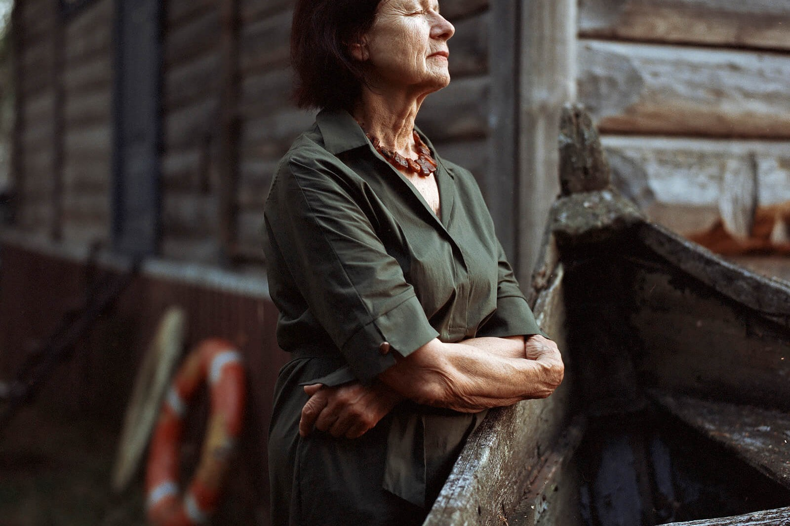 Tadas Kazakevicius - Between Two Shores the south west collective of photography ltd women stood outside log cabin