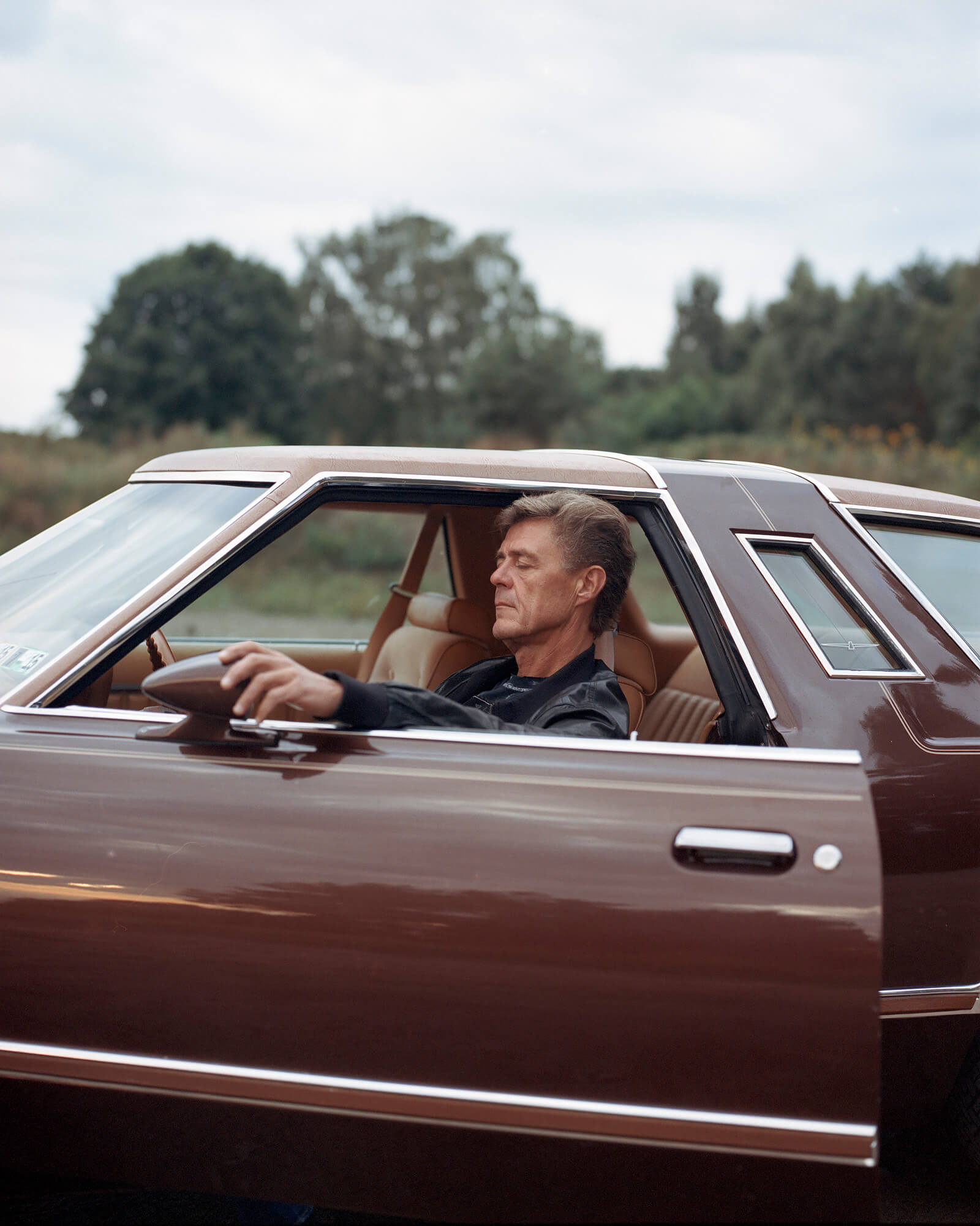 Tadas Kazakevicius - Between Two Shores the south west collective of photography ltd man sat in car