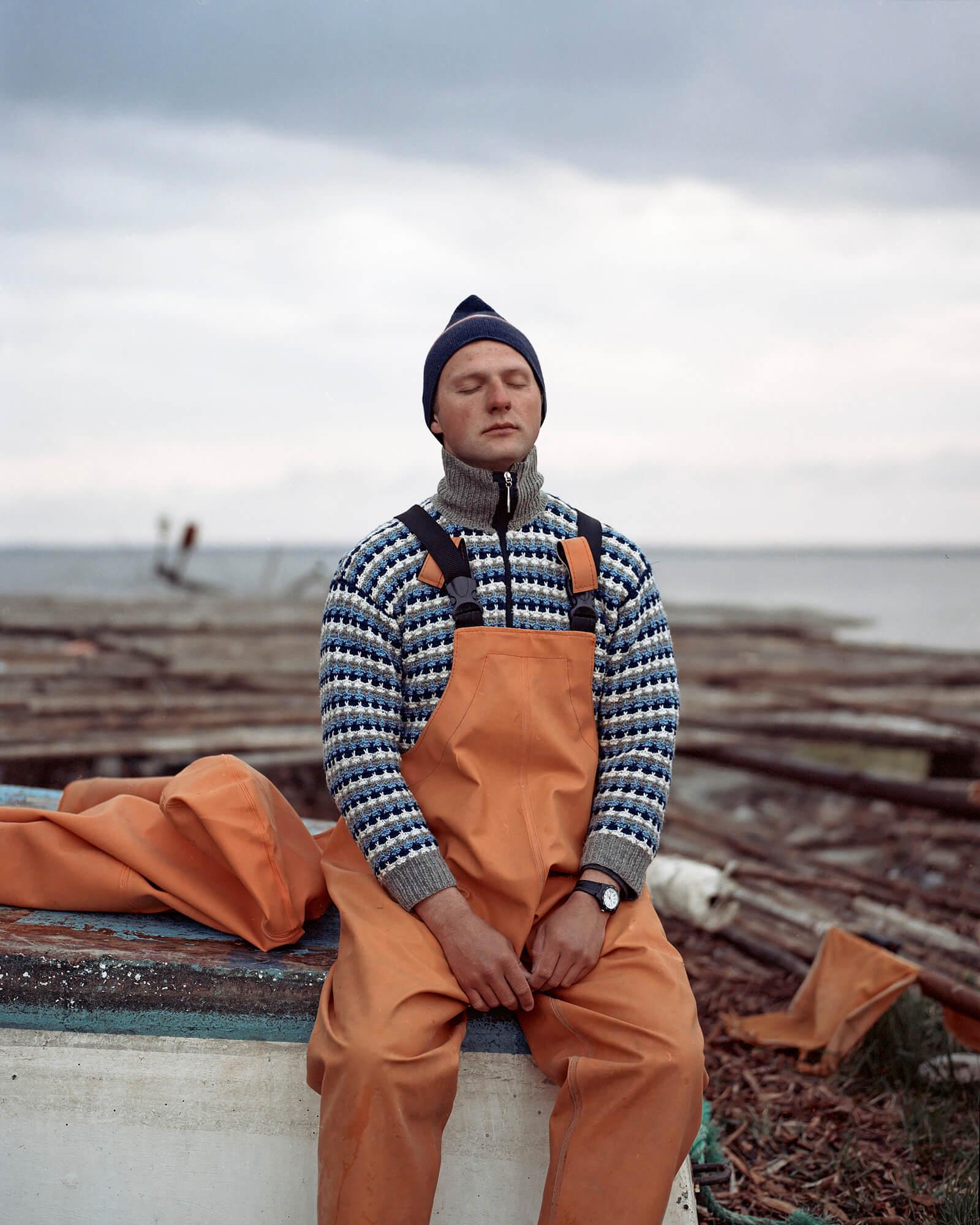 Tadas Kazakevicius - Between Two Shores fisherman on beach