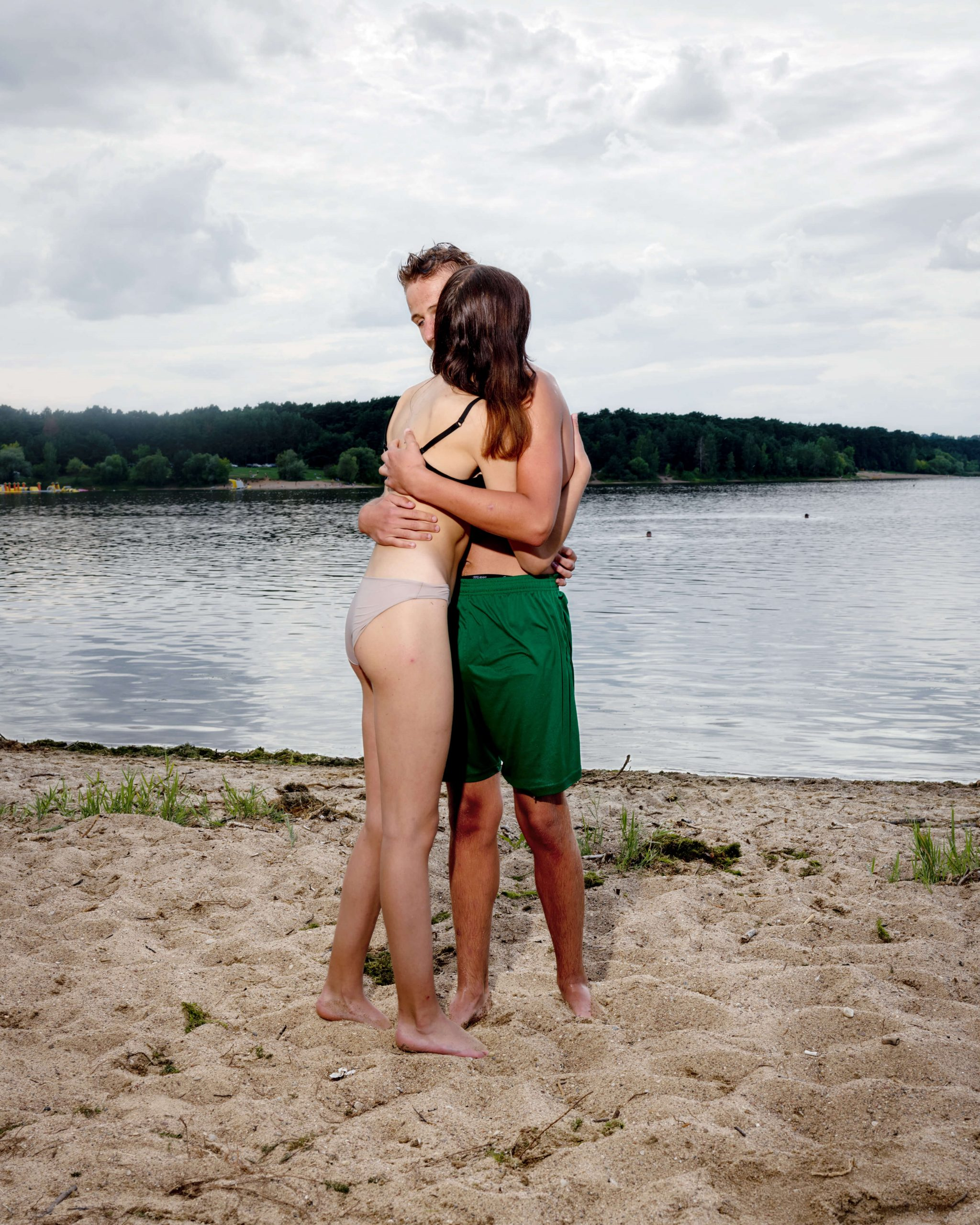 THE EUROPEANS -Arnold van Bruggen & Rob Hornstra the south west collective of photography couple hugging on a beach