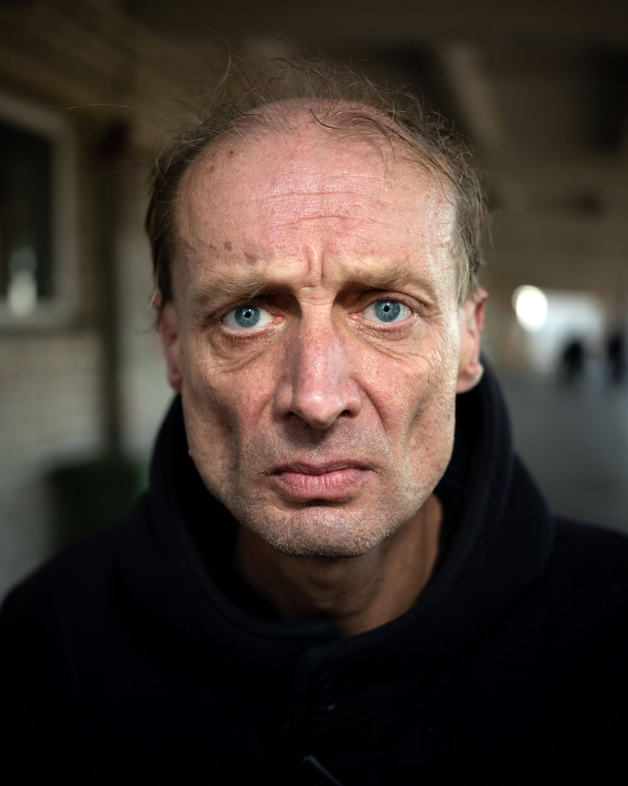 THE EUROPEANS -Arnold van Bruggen & Rob Hornstra the south west collective of photography ltd close up portrait of man with blue eyes