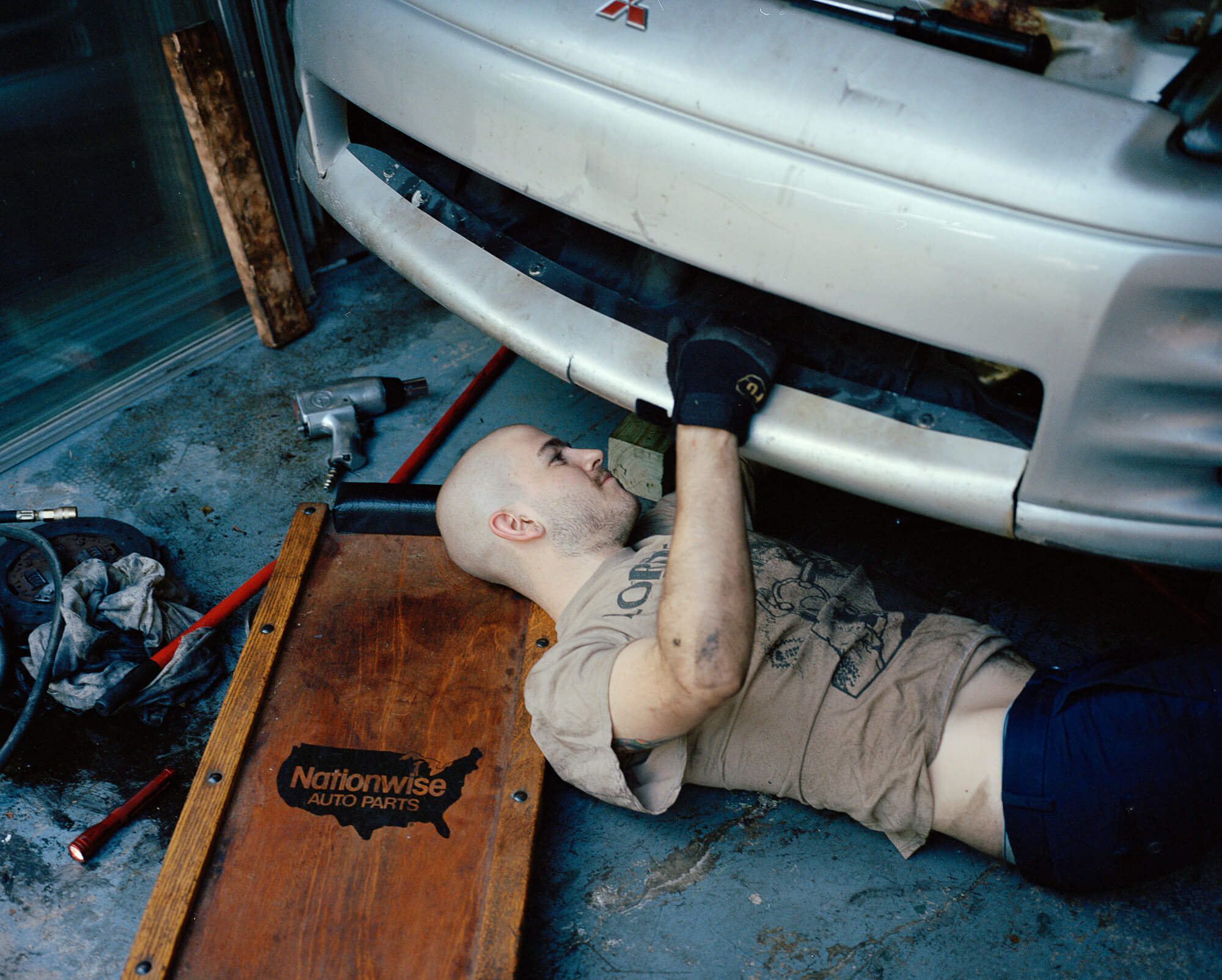 Caroline Tompkins Fantasy Body the south west collective of photography ltd man fixing car