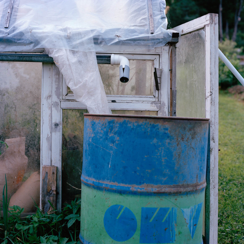 Kadri Otsiver - Ta aed on tema nägu (Her garden has her face) Greenhouse interior and blue barrel