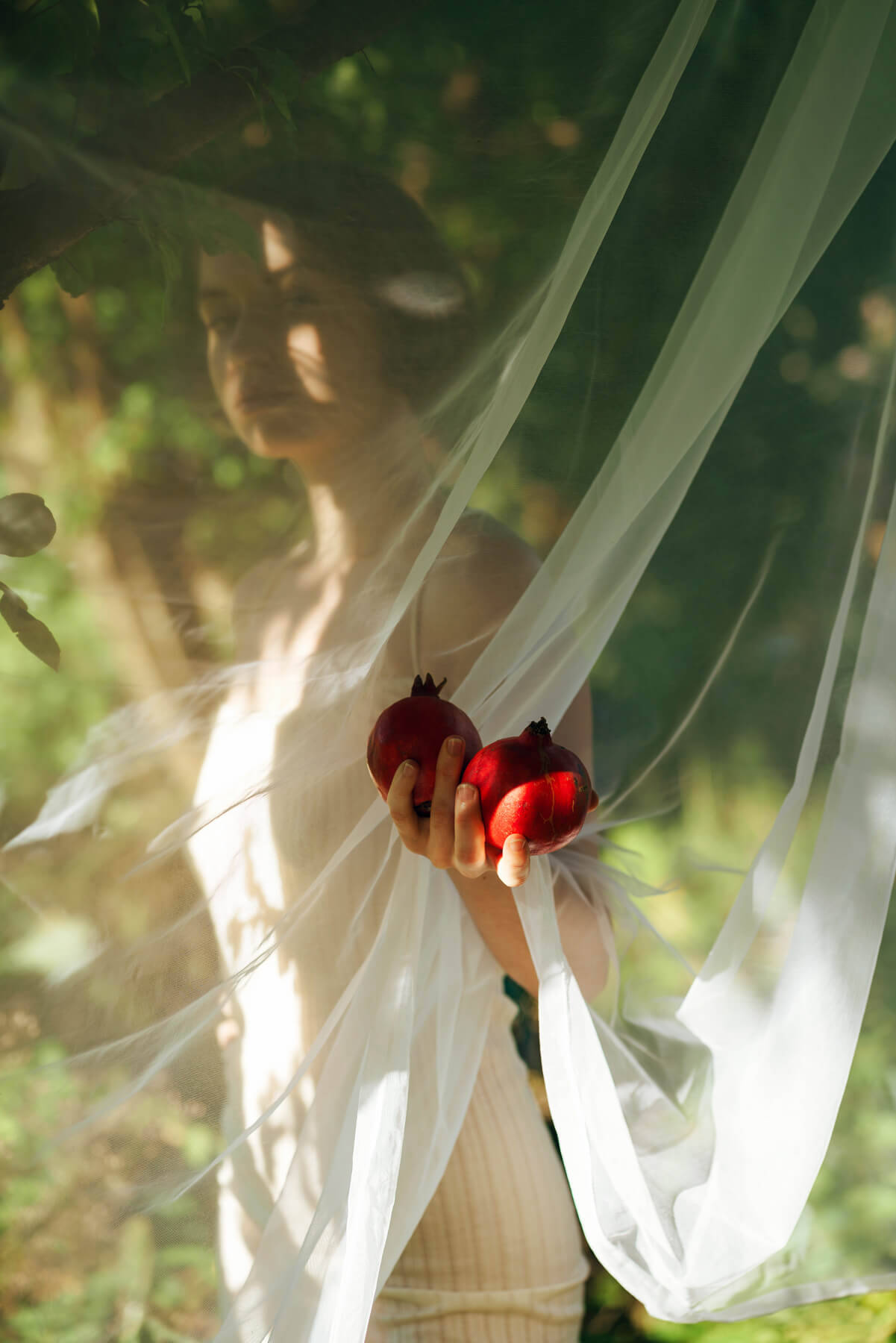 Nadja Ellinger - Path of Pins woman with sheet over head holding apples