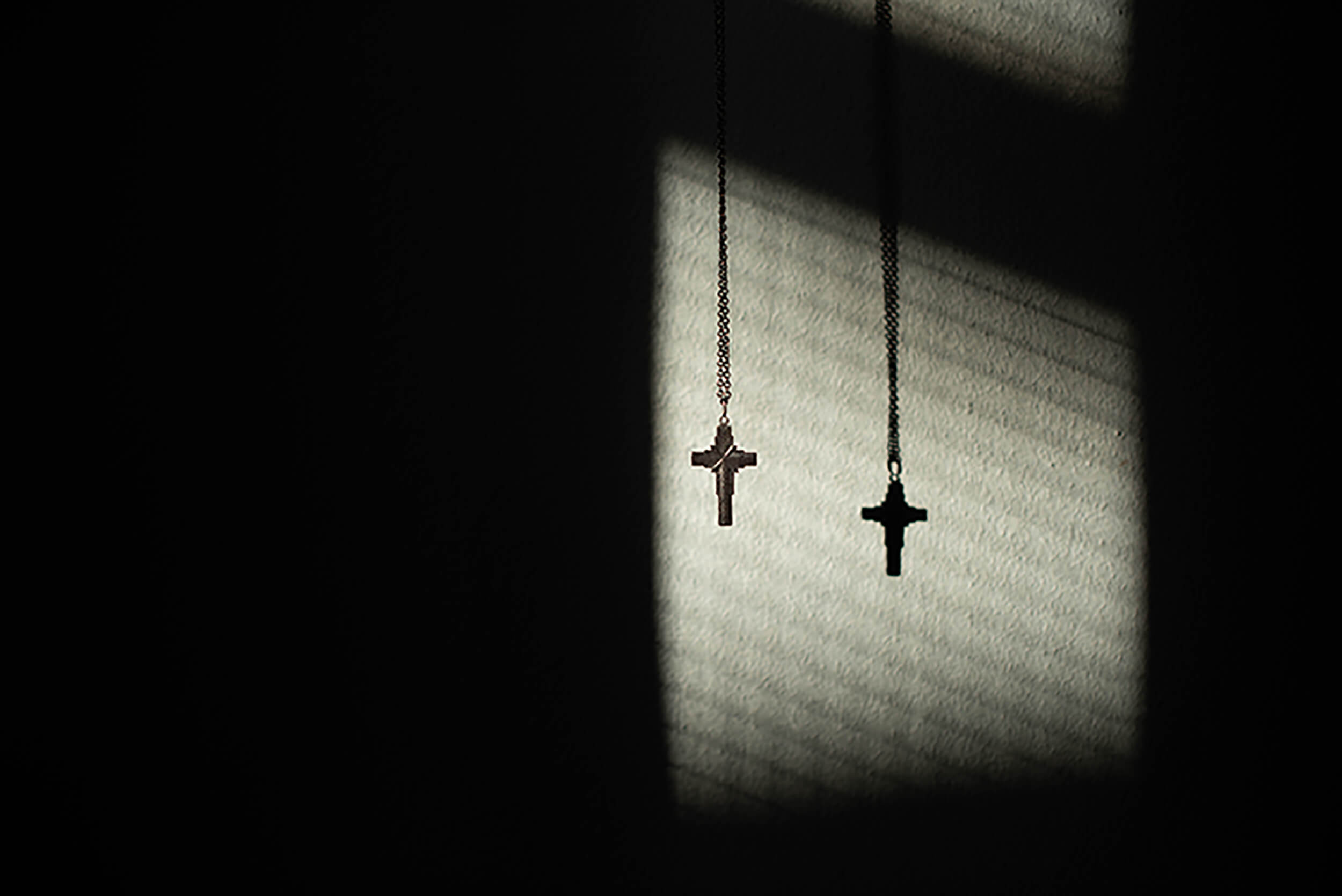Martin Skraban - Incurable crosses hanging in sunlight
