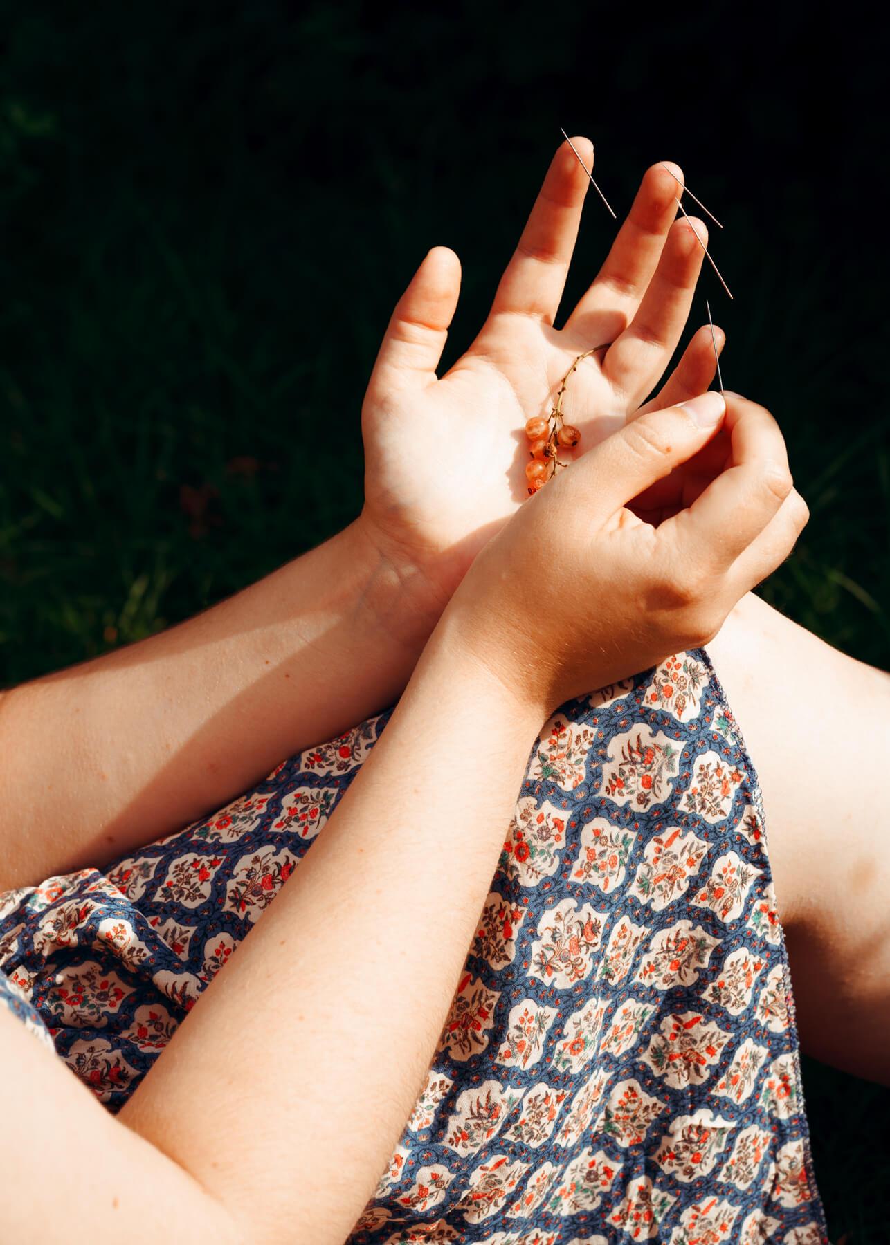 Nadja Ellinger - Path of Pins woman holding berries