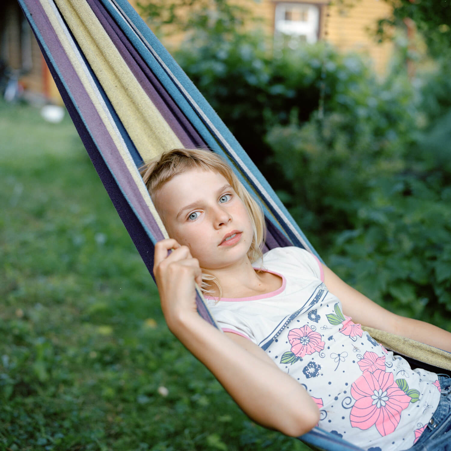 Portrait of young girl in colourful hammock