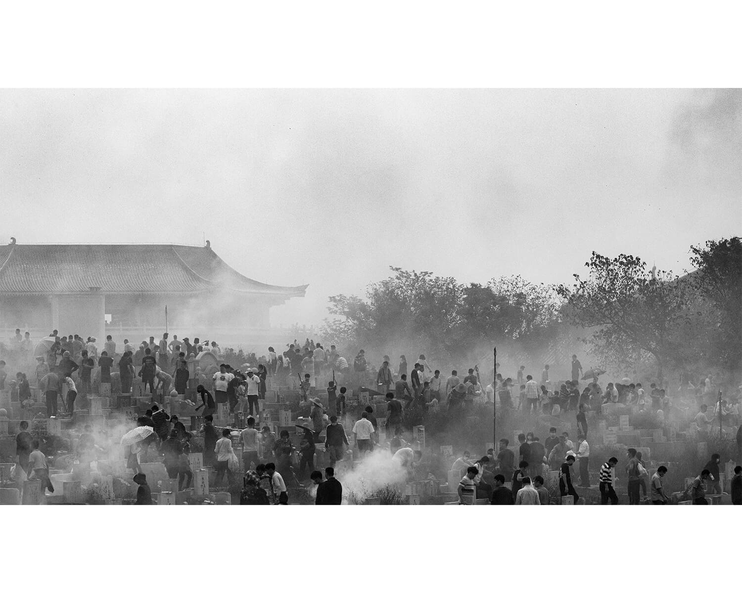 Tony Mak - To The West Of The Solitary Sea. Crowds of people in front of building and smoke