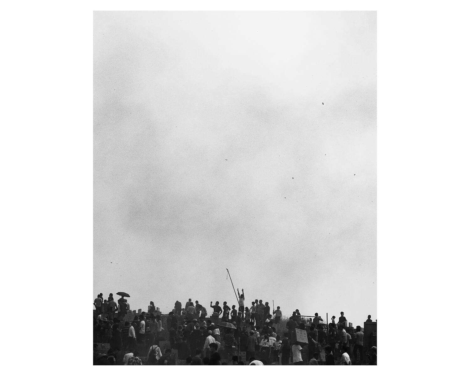 Tony Mak - To The West Of The Solitary Sea. Crowds of people and grey sky