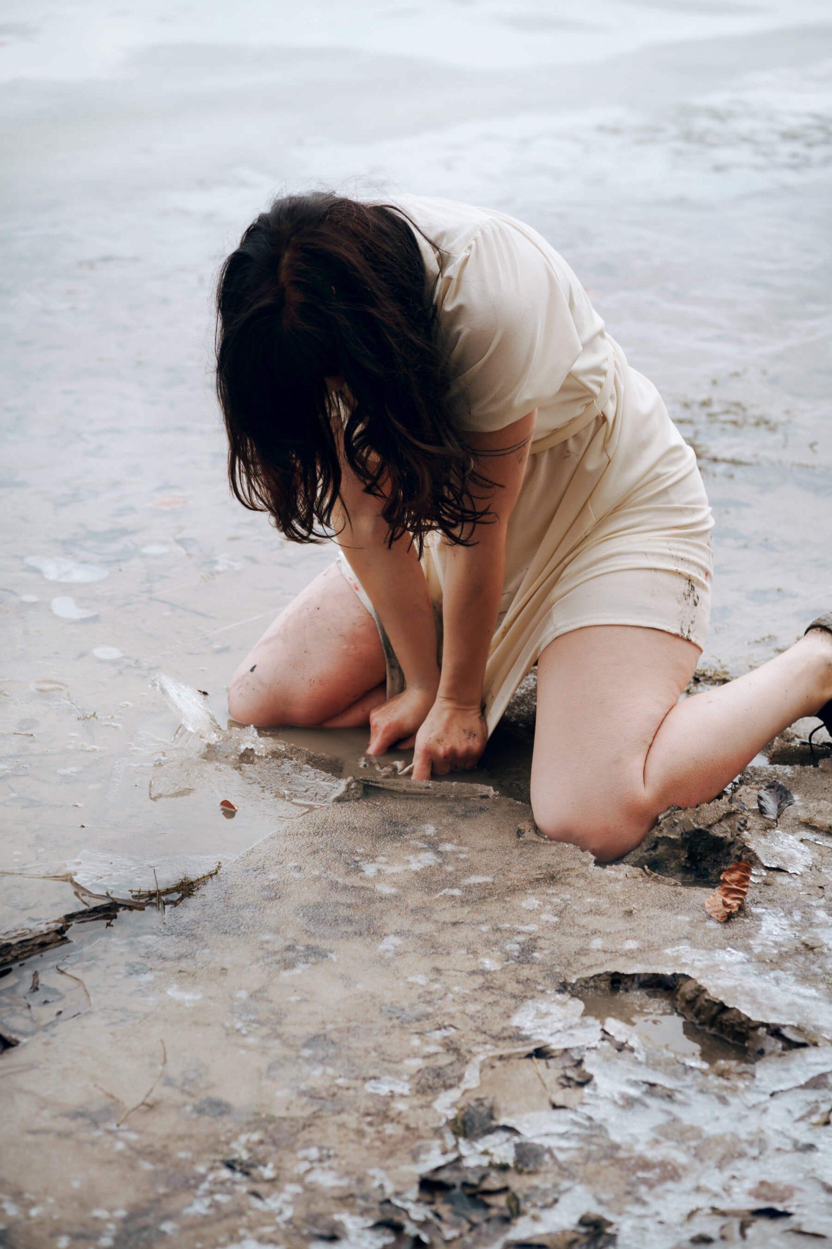 Nadja Ellinger - Path of Pins girl pushing down on fish