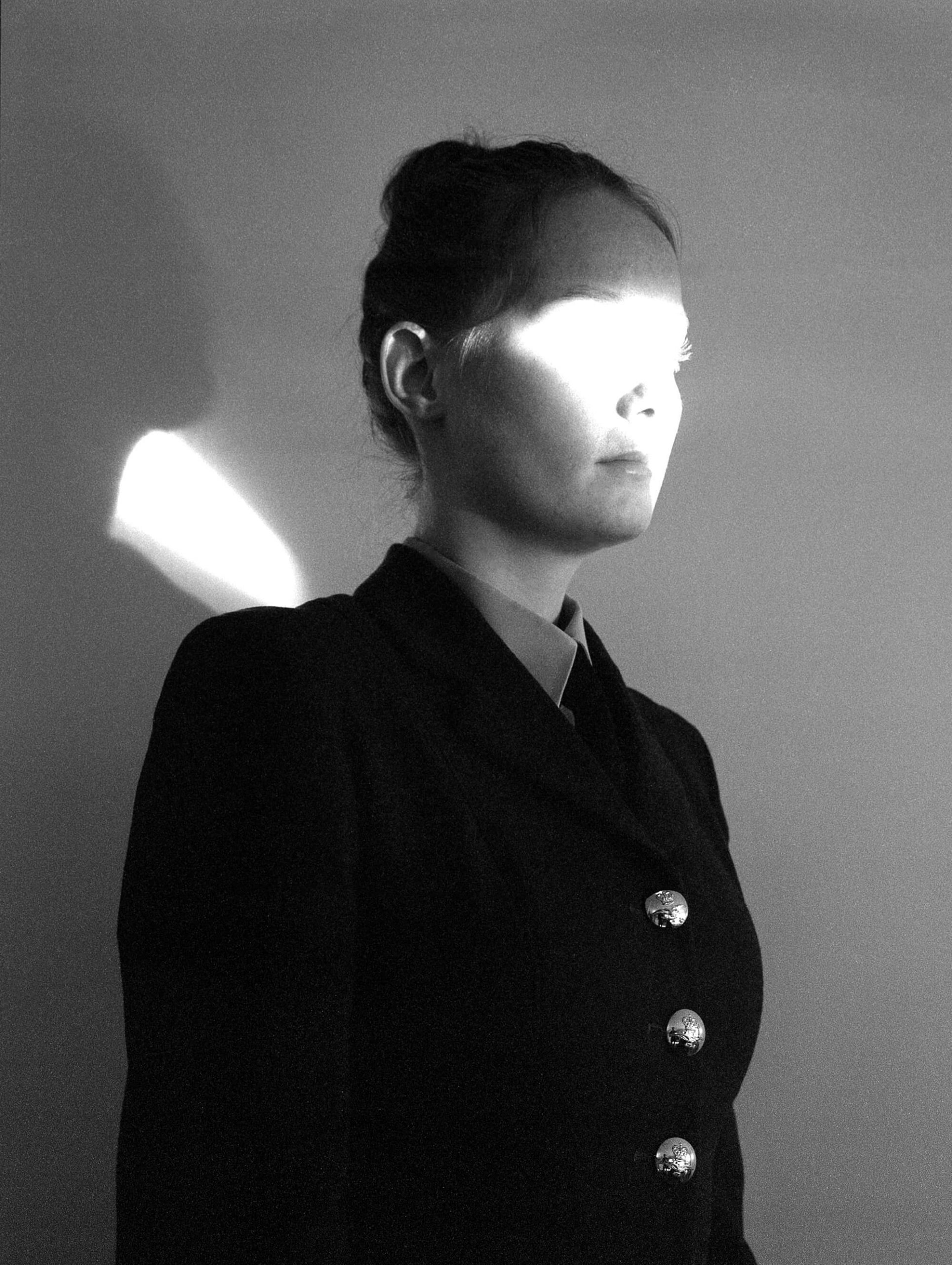 Rosie Dale - Ad Astra portrait of girl with light on her face