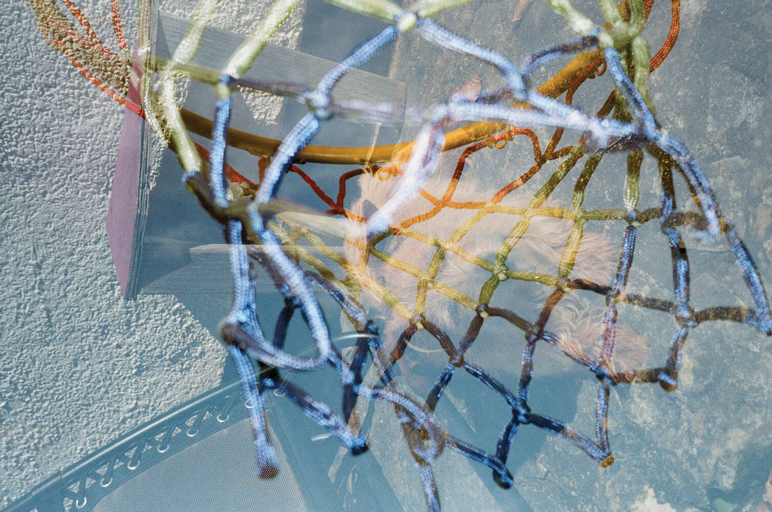 Tiana Ferguson - Fool Me Once, Fool You Twice. Double exposure of netted material and blue colours