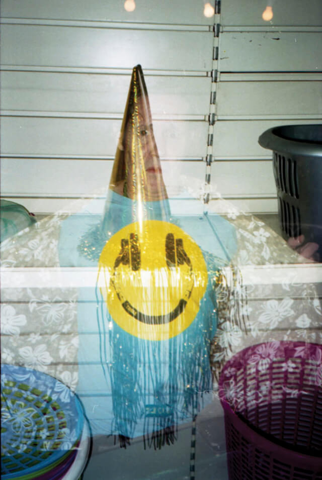Tiana Ferguson - Fool Me Once, Fool You Twice. Double exposure of smiley face