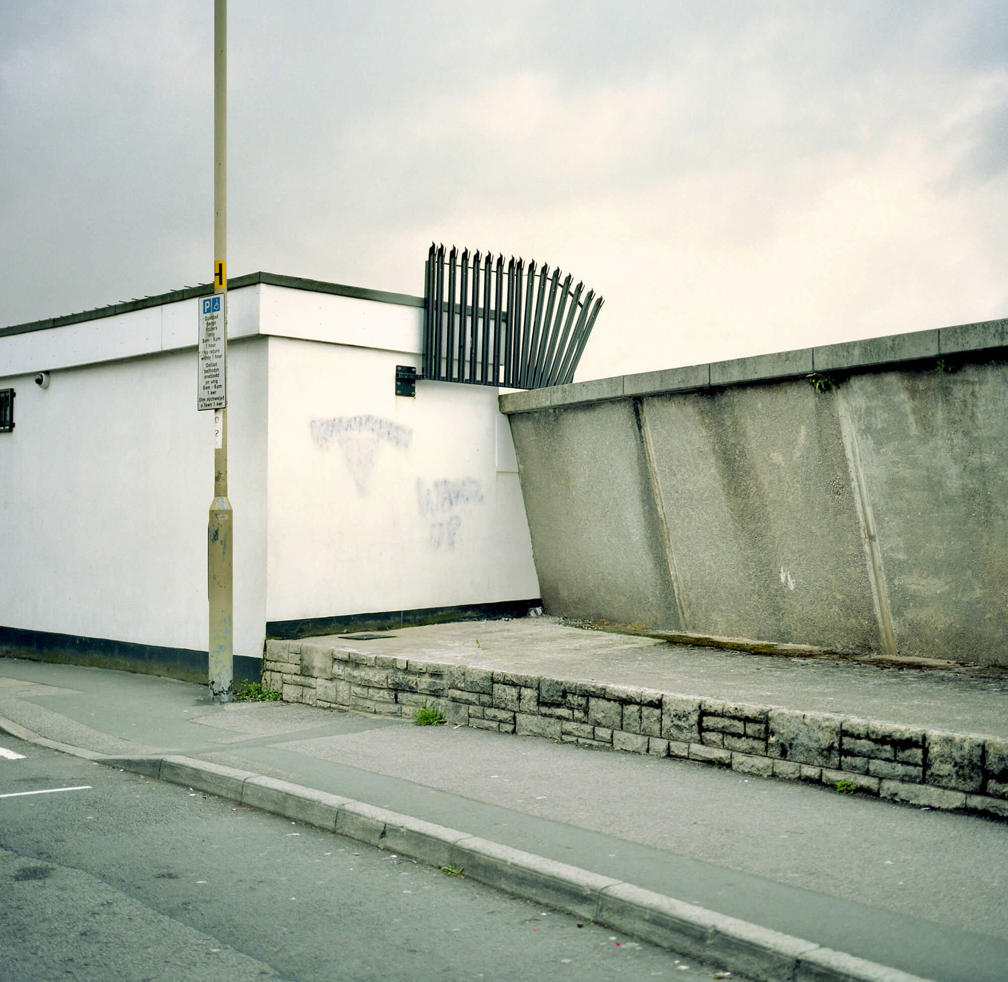 Fence on Grey wall Book Review - Dan Wood 'Suicide Machine' the south west collective of photography