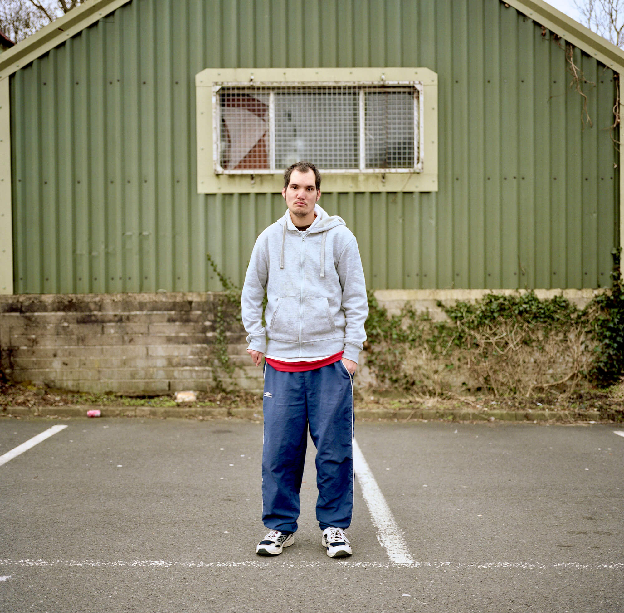 Book Review - Dan Wood 'Suicide Machine' the south west collective of photography man stood in car park